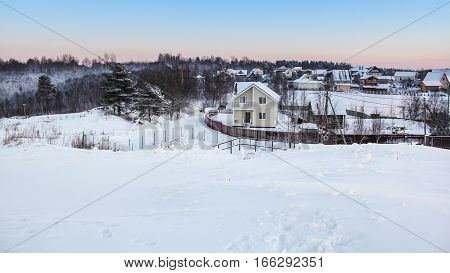 Country village in winter. Winter night scenery and countryside views of the sunset.