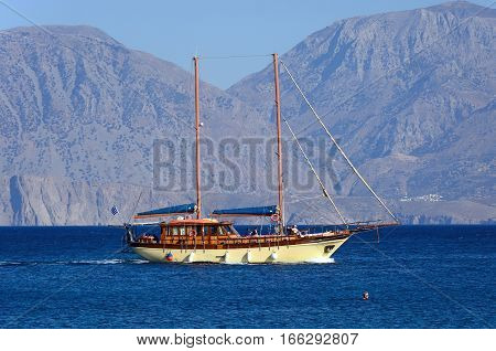 AGIOS NIKOLAOS, CRETE - SEPTEMBER 17, 2016 - Large yacht with two masts in the bay with mountains to the rear Agios Nikolaos Crete Greece Europe, September 17, 2017.