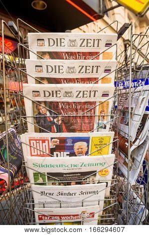 PARIS FRANCE - JAN 21 2017: German newspapers Die Zeit Bild Suddeutsche Zeitung Neue Burcher Zeitung Taz am wochenende at newsstand featuring headlines with Donald Trump inauguration as the 45th President of the United States in Washington D.C