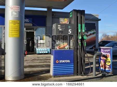 MONCHEGORSK, RUSSIA - APRIL 03, 2016: Car fueling at entrance to town. On column is information on how to use refueling equipment and reminder of