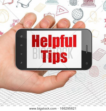 Learning concept: Hand Holding Smartphone with  red text Helpful Tips on display,  Hand Drawn Education Icons background, 3D rendering