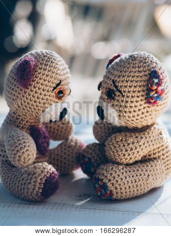 Two teddy bears on a wooden table