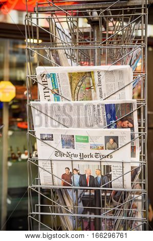 PARIS FRANCE - JAN 21 2017: The New York Times and The Guardian international newspaper from a newsstand featuring headlines with Donald Trump inauguration as the 45th President of the United States in Washington D.C