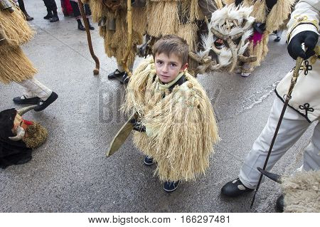 BREZNIK BULGARIA - JANUARY 21 2017: Masked child player called