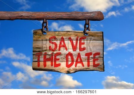 Save the date motivational phrase sign on old wood with blurred background
