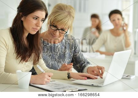 young women working at office, business concept