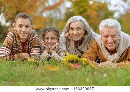 Portrait of a grandchildren with their grandparents posing outdoors