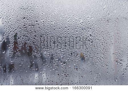 Rain drops on window winter spring sad