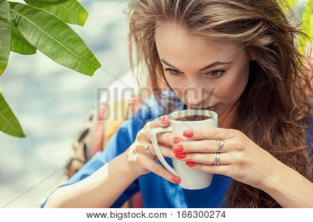 Gorgeous Woman Drinking Coffe In A Cafe