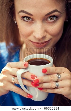 Woman Drinking Coffe And Looking At Camera