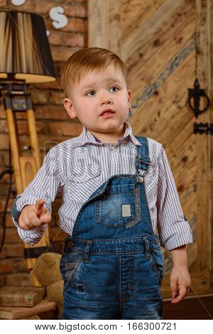 Small boy smilling in fashon jeans solo