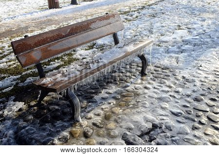 Ice, Snow And Stalactites On A Bench