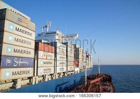 Slavianka Russia - April 1th 2015: Anchorage of port Slavianka the tanker Vladimir Vysotsky bunkering container ship Cezanne.