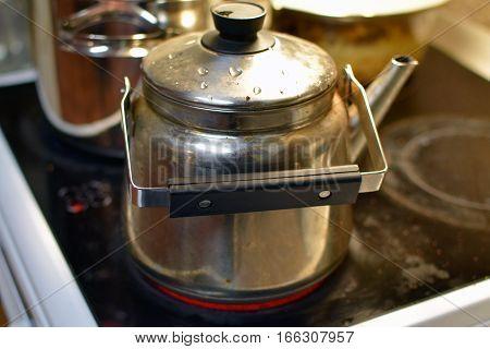Old coffee pan / pot  on stove.