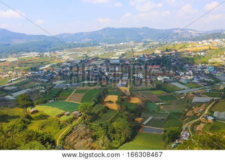 Beautiful view of Da Lat city (Dalat) on the blue sky background in Vietnam. Da Lat is a popular tourist destination of Asia.