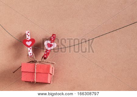 Heart-shaped of pin and gift on the wire.