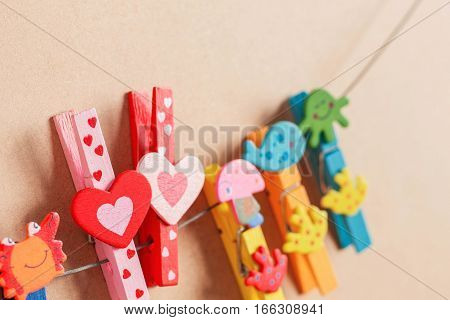 Heart-shaped pin on the wire with colorful.