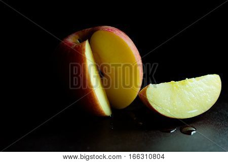 Apple and side of apple with moody and dark style and background