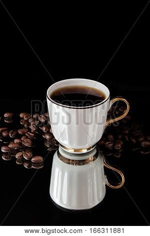 Graceful Cup Of Coffee And Roasted Coffee Beans On Black Background.