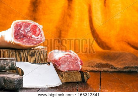 Parts of pork on the block and wood cutting boards. Rustic chopper