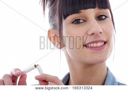 young brunette smiling woman breaking cigarette no smoking concept
