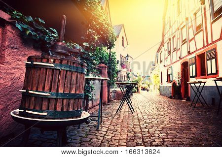 Narrow cobblestone street in old town at summertime. Cityscape Alsace France