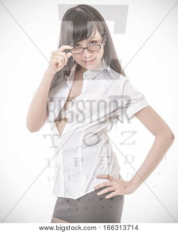 Beautiful Asian woman wearing glasses with eyesight test chart overlay