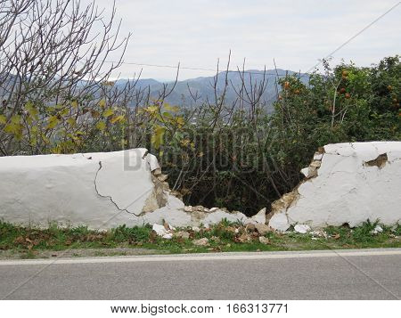 Large hole in Damaged wall in Andalusian village