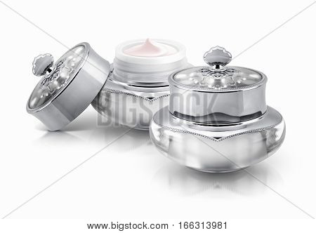 Two silver deluxe cosmetic jar on white background