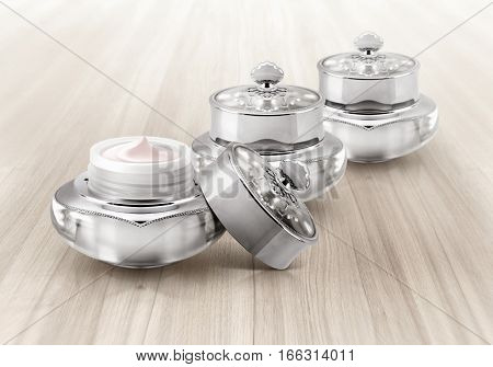 Silver deluxe cosmetic jar on wood background
