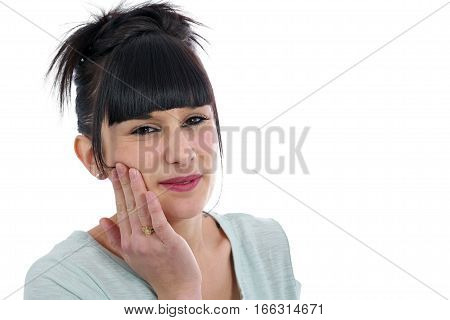 young brunette with a toothache isolated on white background