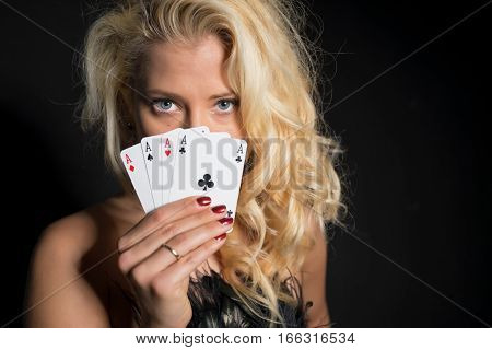 Flirty and seductive woman showing her cards
