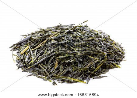 Heap of leaves of green japanese sencha tea closeup frontview isolated on white background.