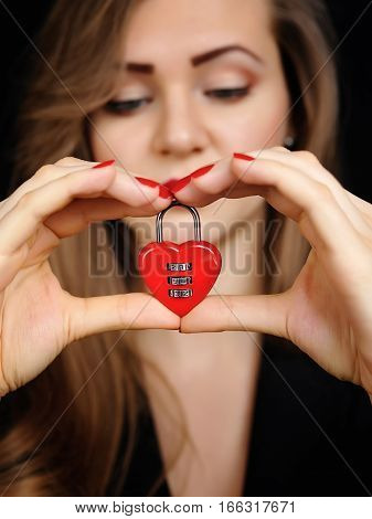 Beautiful Girl With Padlock Heart-shape In Hands