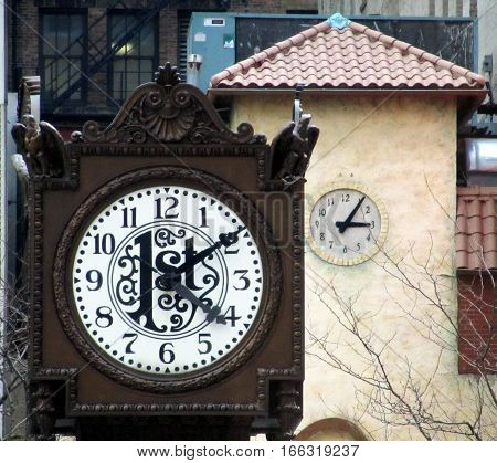 Tow Clock Towers and Two Different Times
