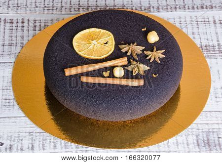 Chocolate velour Christmas mousse cake with some decoration)