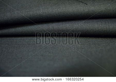 close up roll pattern gray fabric of suit photo shoot by depth of field for object