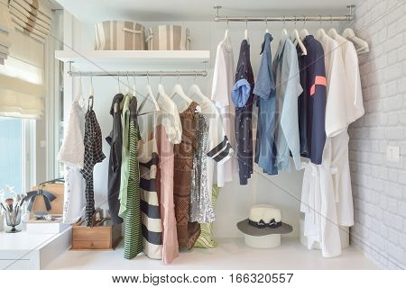Youth Cloths Hanging In Open Wardrobe In The Bedroom