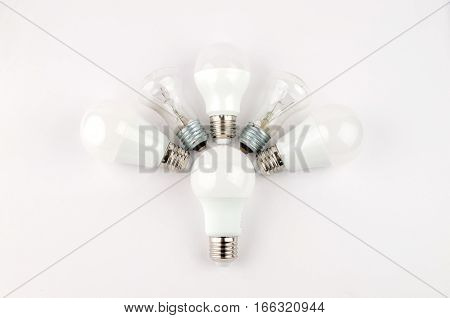 several LED energy saving light bulbs over the old incandescent, use of economical and environmentally friendly light bulb concept, the choice of old or new