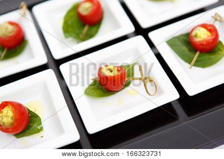canape red cherry tomatoes cheese small plate leaf catering