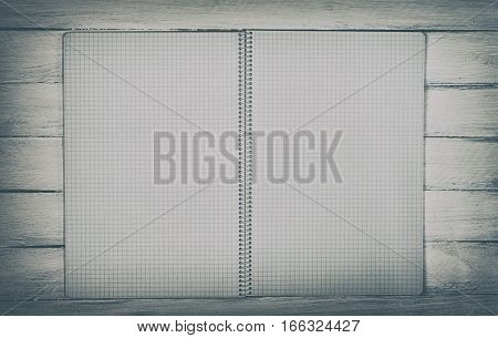open notebook on a white wooden surface top view vintage toning