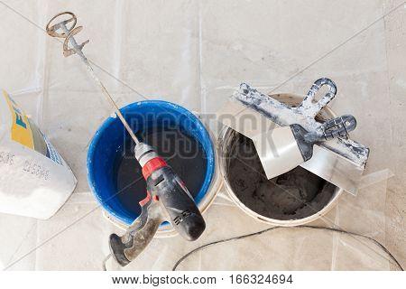 Hand mixer for mortar spatula. Building tools.
