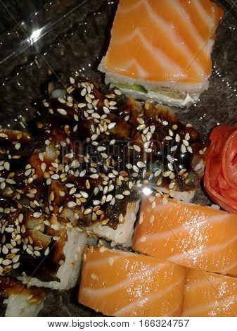 Sushi - traditional Japanese dishes made from rice and various fillings or layers, which are dominated by marine products