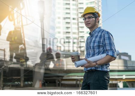 Foreman construction worker holding blueprint, architect site