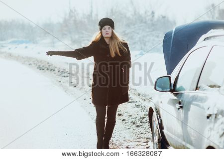 Girl on the road near the car