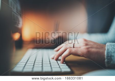Closeup view of female hands typing keyboard.Selective focus on hand.Blurred background.Horizontal