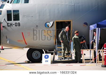 IZMIR, TURKEY - JUNE 5, 2011: This image shows a American pilot descend the stairs of the C-130 Hercules transportation aircraft during the 'Turkish Air Force 100th Anniversary' air show at 2nd Main Jet Base Cigli, Izmir Turkey.