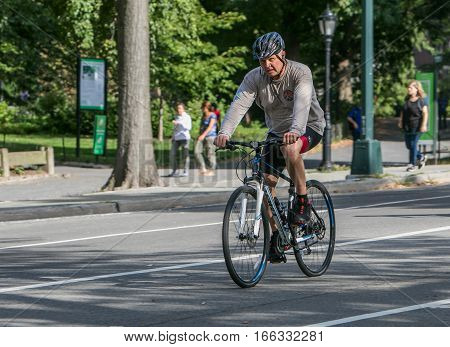 New York, September 17, 2016: A man riding a bicycle.