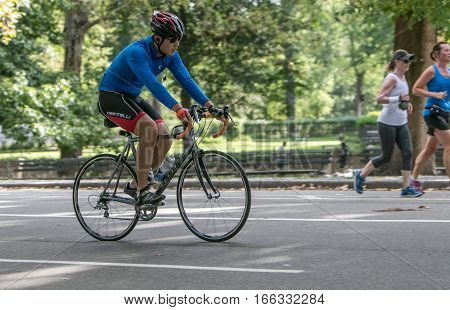 New York, September 17, 2016: A man riding a bicycle in Central Park.