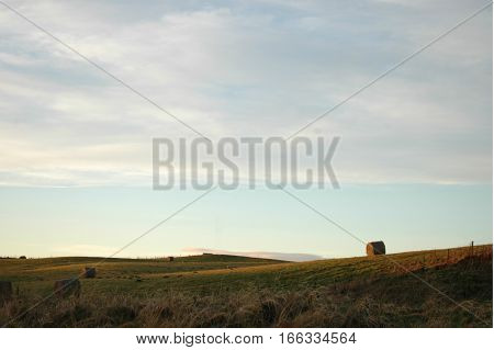 Hay bales and field in the Aberdeenshire countryside